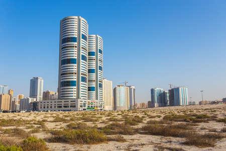 sharjah: SHARJAH, UAE - NOVEMBER 01, 2013: General view of modern buildings in Sharjah. It is the most industrialized emirate in UAE.