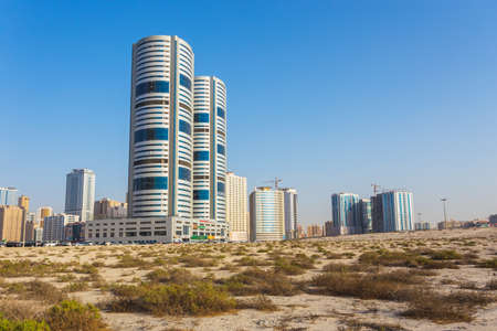 industrialized: SHARJAH, UAE - NOVEMBER 01, 2013: General view of modern buildings in Sharjah. It is the most industrialized emirate in UAE.
