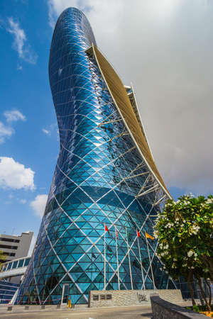 furthest: ABU DHABI, UAE - NOVEMBER 5: The Capital Gate Tower on the November 5, 2013 in Abu Dhabi, This is certified as the Worlds Furthest Leaning Manmade in the world. it is in the heart of the business area. Editorial