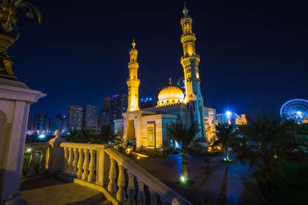 sharjah: Al Noor Mosque in Sharjah at night. United Arab Emirates