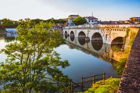 past civilization: Bridge of Tiberius (Ponte di Tiberio) in Rimini, Italy. Stock Photo