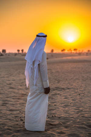 Arab in the Arabian desert on a hot sunny day Stock Photo