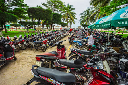 NHA TRANG, Vietnam - NOV 22, 2014: Motorcycles of many brands parking on a street side of NHA TRANG capital. Motorcycle is the most popular vehicle in Vietnam.