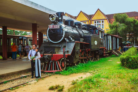 railway history: DALAT, VIETNAM - NOV 26, 2014.  Ancient station is famous place, history destination for traveler, with railway, antique train transport tourist to visit in Dalat, Vietnam Editorial
