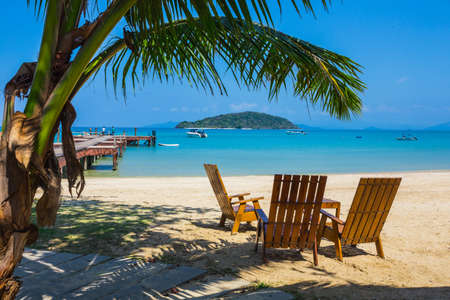 beach panorama: Tropical beach panorama with deckchairs, boats and palm tree. THAILAND