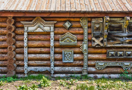 inhabited: Traditional wooden Russian carved platband of an old wooden house in the province city Stock Photo