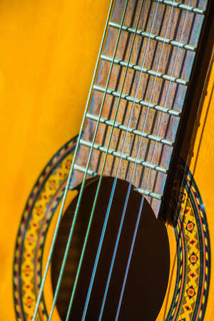 middle joint: Acoustic classical guitar. Close-up deck and strings Stock Photo