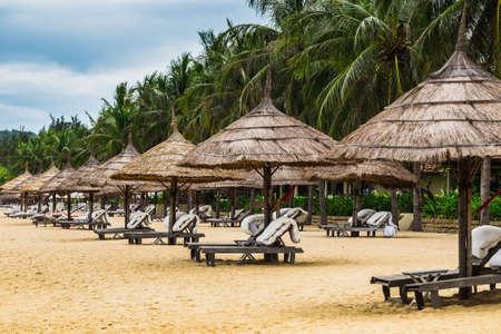 beach chairs: Beach chairs and umbrellas  on exotic tropical white sand beach