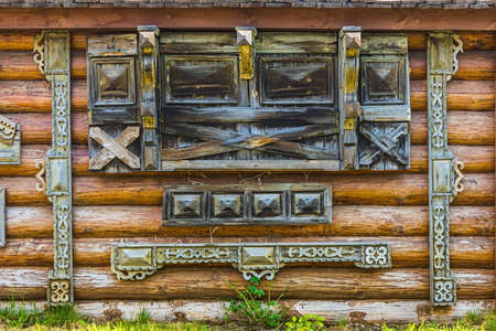 squalid: Traditional wooden Russian carved platband of an old wooden house in the province city Stock Photo