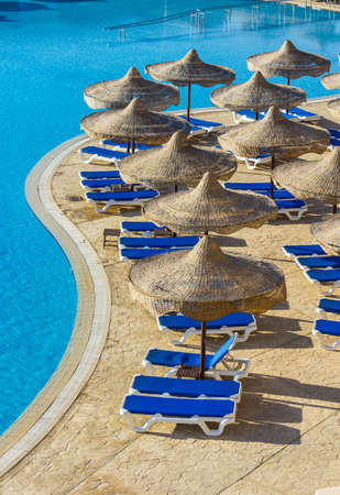sun umbrellas: The view from the window of the hotel in Egypt to the pool, sun umbrellas and the Red Sea
