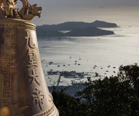marmorate: view with the bell of Big Buddha on the island and a yacht in Phuket