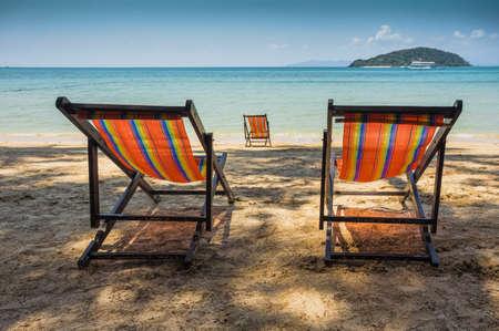 beach chair: sun beach chairs on shore near sea. Thailand Stock Photo