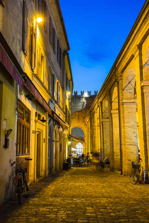 eventide: RIMINI, ITALY - JUNE 27, 2014: Street in the old town at night