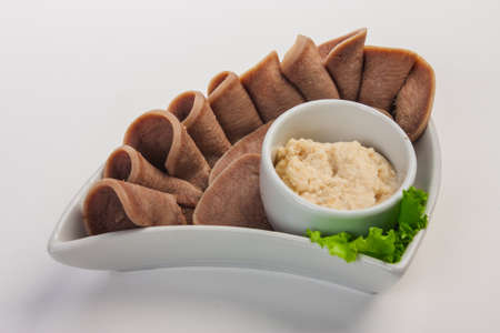 horseradish sauce: Boiled beef tongue with horseradish sauce and salad