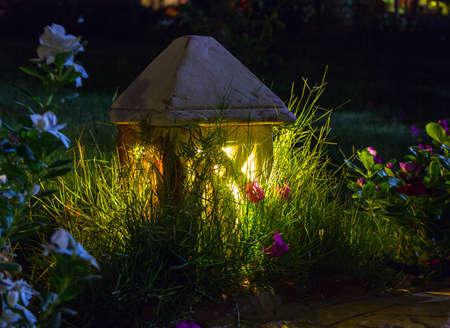 garden lamp: Small ceramic Garden Lamp on surrounded grass field Stock Photo