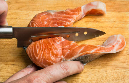 butchering: butchering of salmon on a cutting board