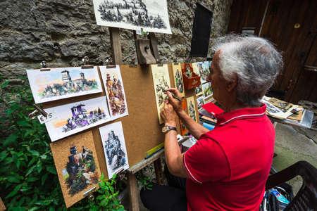 masters of rock: SAN MARINO REPUBLIC - JUNE 22, 2014: artist in Rocca della Guaita, the most ancient fortress of San Marino, Italy Editorial