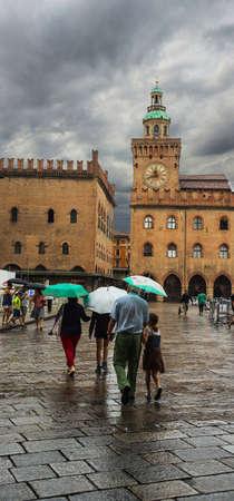 june 25: BOLOGNA, ITALY - JUNE, 25: view of Piazza Maggiore with Accursio Palace and Palazzo del Podesta. Palazzo del Podesta was was built around 1200. Bologna, Italy on June 25, 2014 Editorial