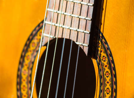 concert flute: Acoustic classical guitar. Close-up deck and strings Stock Photo