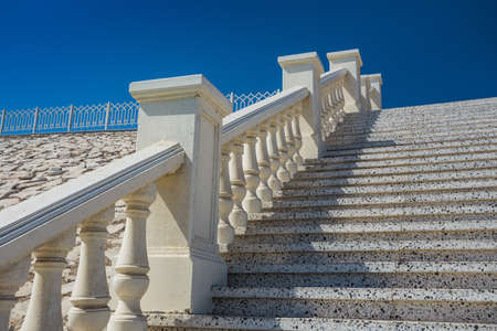 bannister: A stone staircase with white balustrade outdoor