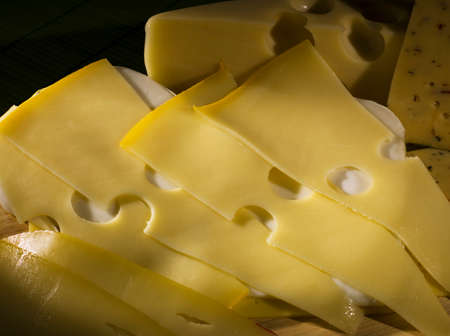 thinly: the cut thinly slices of a cheese