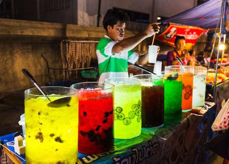 traders: PATTAYA, THAILAND - APRIL 4, 2015; traders at the night market in Thailand Editorial