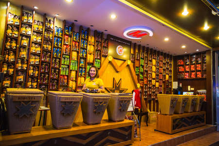 COSTUMERS: Nha Trang, Vietnam. November 22, 2014. The shop with different varieties of the national Vietnamese coffee Editorial