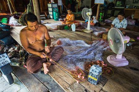 fish net: Thailand 2015 APR 1, fisherman repair fish net in Koh Chang fisherman villages, Koh Chang,Thailand. Editorial