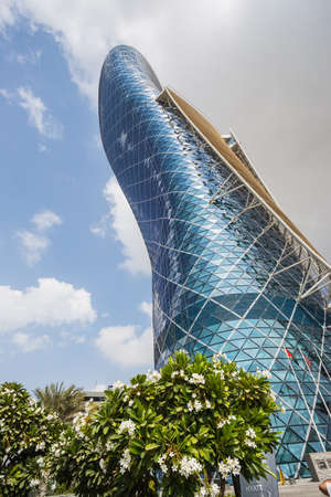 manmade: ABU DHABI, UAE - NOVEMBER 5: The Capital Gate Tower on the November 5, 2013 in Abu Dhabi, This is certified as the Worlds Furthest Leaning Manmade in the world. it is in the heart of the business area. Editorial