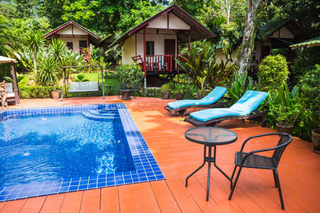 KOH CHANG, THAILAND - APRIL 2, 2015: Hotel Saint Tropez. Swimming pool in a tropical garden Editorial