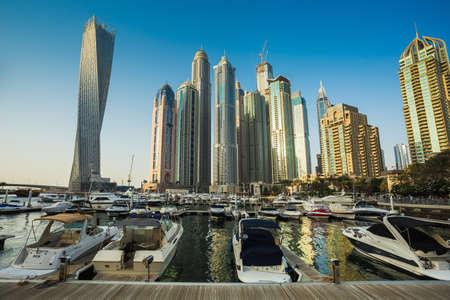 fastest: DUBAI, UAE - NOVEMBER 2: Dubai Marina. UAE. November 2, 2013. Dubai was the fastest developing city in the world between 2002 and 2008. Editorial