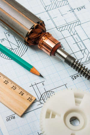 delineation: electrical components and stationery measuring tools against drawings