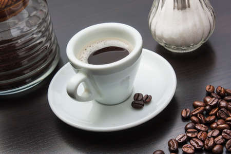 invigorate: cup of black coffee with biscuits Stock Photo