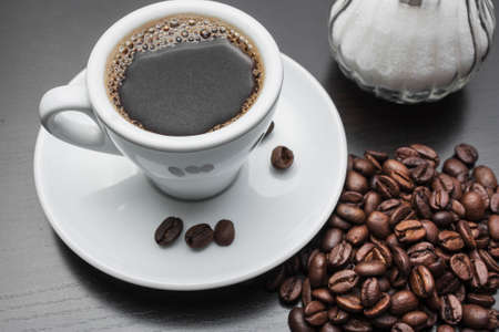 hot coffees: cup of black coffee with biscuits Stock Photo