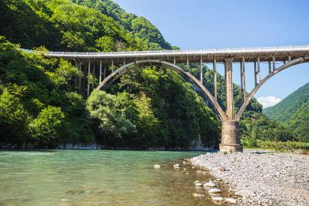 abkhazia: Landscape in Abkhazia with the stone bridge over river Gumista