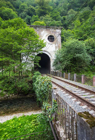 Railroad tunnel Psyrtsha station in New Athos, Abkhazia Stock Photo