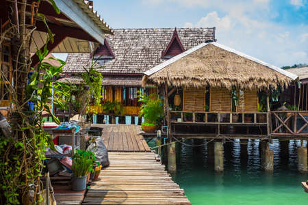slums: KOH CHANG, THAILAND -  April 3, 2015: Houses on stilts in the fishing village of Bang Bao Editorial