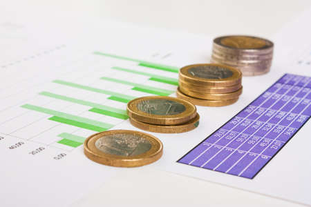 settlement: financial settlement with the charts and coins Stock Photo