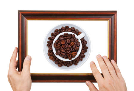 Photo Frame with a cup of coffee in the hands isolated on white background