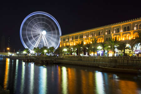 SHARJAH, UAE - OCTOBER 29, 2013: Eye of the Emirates - ferris wheel in Al Qasba - Shajah, United Arab Emirates Editorial