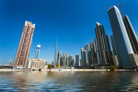 DUBAI, UAE - NOVEMBER 13: High rise buildings and streets nov 13. 2012  in Dubai, UAE. Dubai was the fastest developing city in the world between 2002 and 2008. Editorial