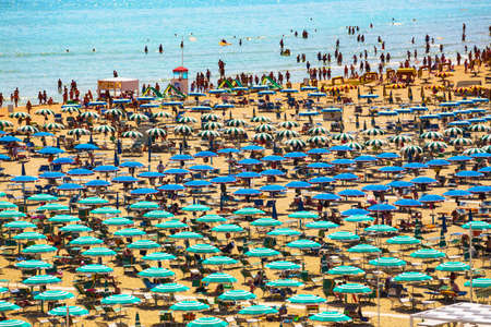 Italy, July 24, 2013. Large group of parasols at the beach of Rimini