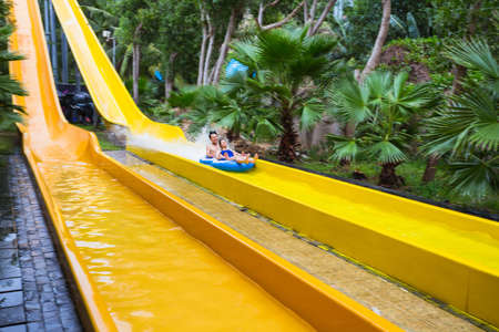 developing country: VINPEARL RESORT, NHA TRANG, VIETNAM - NOV 24, 2014. Colorful waterslide in Vinpearl water park, Nhatrang - Vietnam Editorial