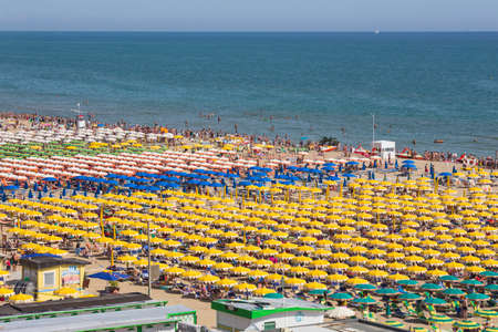 Italy, July 24, 2014. Large group of parasols at the beach of Rimini Editorial