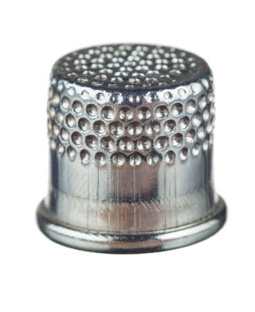 silver thimble for sewing isolated on white background
