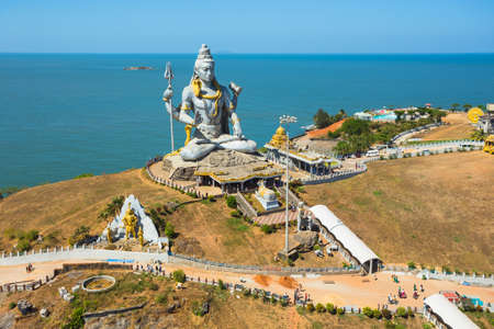MURUDESHWAR, INDIA - MARCH 12 2017: Statue of Lord Shiva was built at Murudeshwar temple on the top of hillock which overlooks the Arabian Sea and it is 37 meters in height.