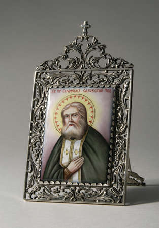 Ancient Russian icon on ceramics in silver frame (St. Seraphim of Sarov)