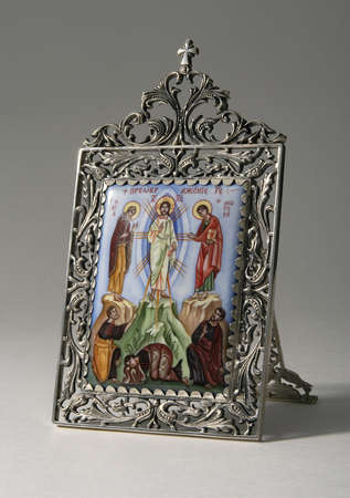iconography: Ancient Russian icon on ceramics in silver frame Stock Photo
