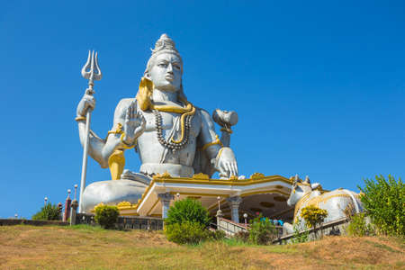 karnataka: MURUDESHWAR, INDIA - MARCH 12 2017: Statue of Lord Shiva was built at Murudeshwar temple on the top of hillock which overlooks the Arabian Sea and it is 37 meters in height.