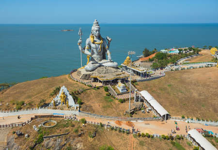 MURUDESHWAR, INDIA - MARCH 12 2017: Statue of Lord Shiva was built at Murudeshwar temple on the top of hillock which overlooks the Arabian Sea and it is 37 meters in height. Stock Photo - 85080671